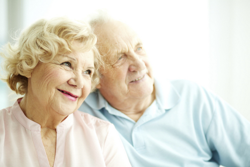 Older couple smiling after making a decision oto get All On 4 Instead of Dentures from their Oral Surgeon in Glendale, AZ at Arrowhead Oral and Maxillofacial Surgery.